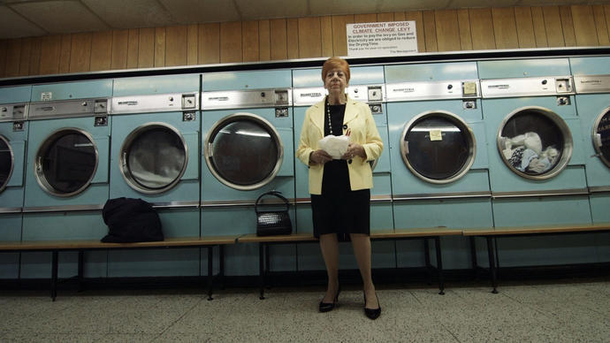 a great photo of a woman in the launderette of the barbican estate from a film produced by ila bêka and louise lemoine