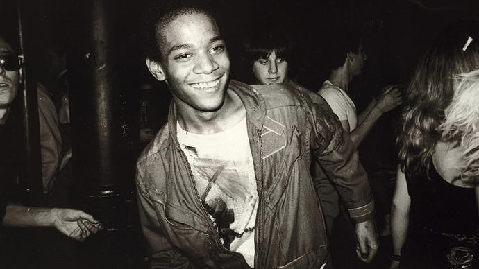 Photo of Jean Michel Basquiat dancing in the Mudd Club