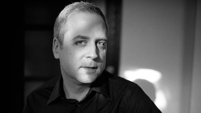 a black and white photo of pianist jeremy denk