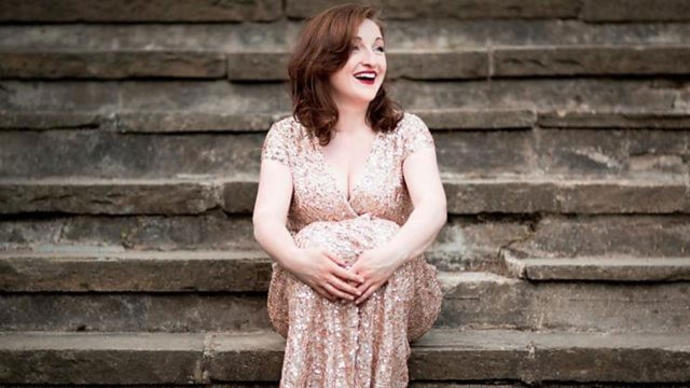 a photo of soprano aylish tynan sitting on some steps