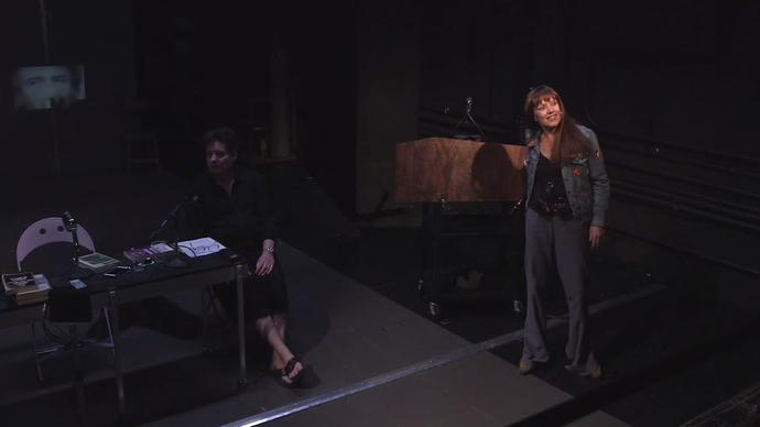 two actors from the Wooster Group on stage