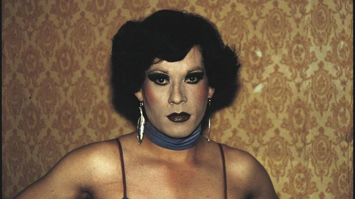 Gazing directly into the camera, Paz Errazuriz's arresting photograph of Pilar, a cross-dresser working in an underground brothel in Chile during the 1980s.