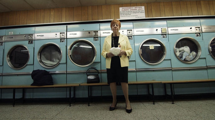 Woman standing in front of washing machines
