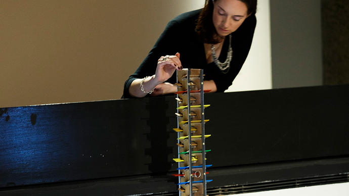 Woman playing with a musical tower