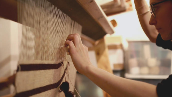 photo of tapestry weaver christy balfour weaving in her studio