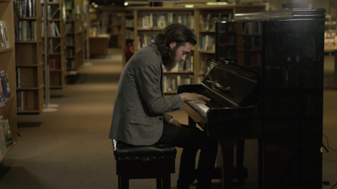 keaton henson playing the piano in our library