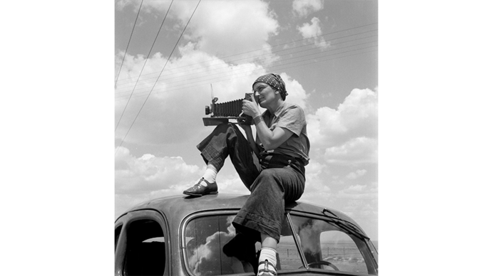 Dorothea Lange with a camera on a truck