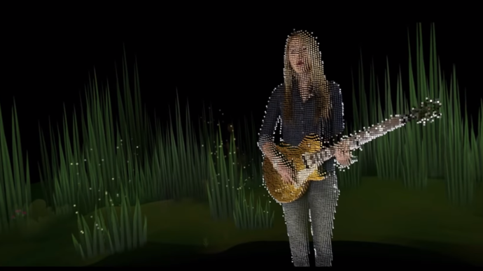 digital rendition of beatie wolfe playing guitar