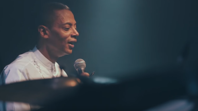 photo of jeff mills wearing a white shirt holding a microphone