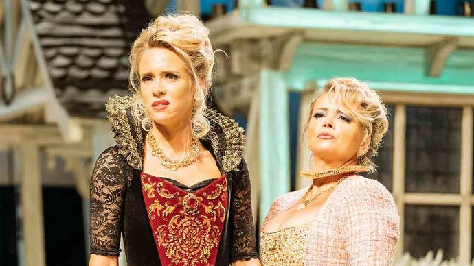 photo of two blonde actress dressed as merry wives of windsor