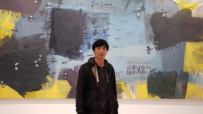 lawrence lek in front of painting