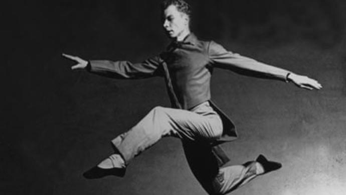 black and white photo of merce cunningham jumping
