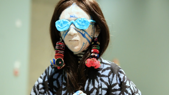 photo of sculpture of woman with blue sunglasses