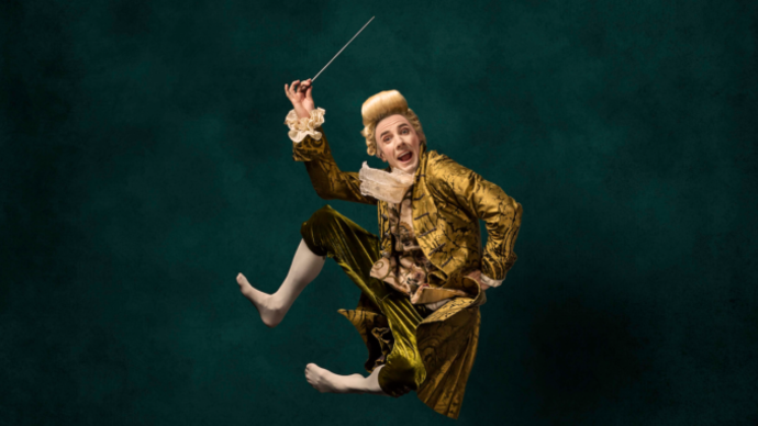 man dressed as mozart jumping