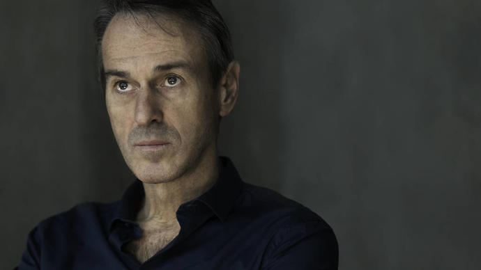ivo van hove looking broodily into the distance