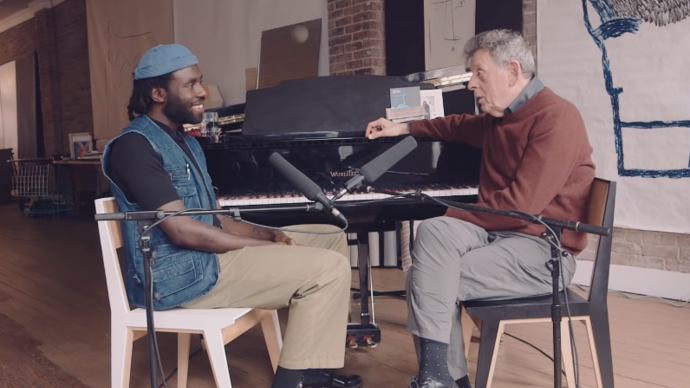 photo of dev hynes and philip glass in front of a piano