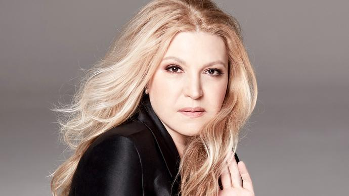 Eliane Elias facing the camera with her hand in her hair
