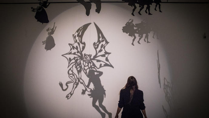 Silhouette of woman in a room full of shadows