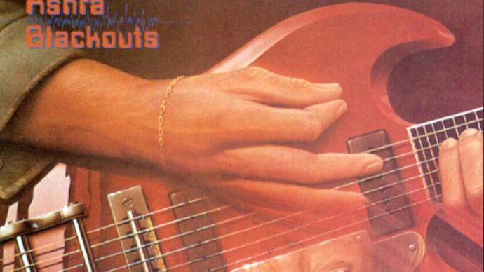 Photo of a painting of hand playing a guitar strings