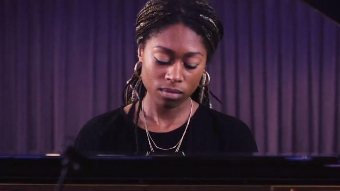Photo of Isata Kanneh-Mason playing the piano