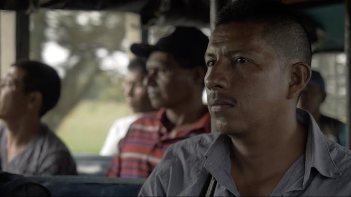 a group of men sit on a bus