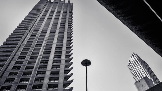 a black and white picture of the barbican towers in central london