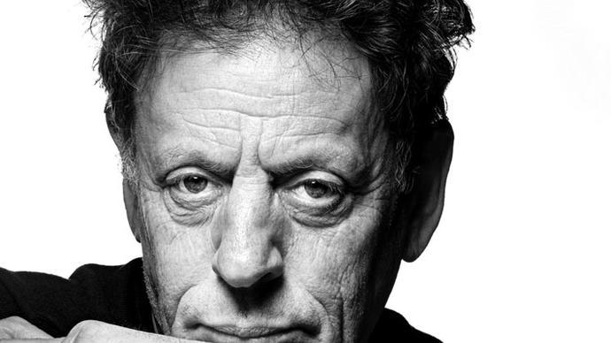 a black and white photo of philip glass in london at the barbican centre