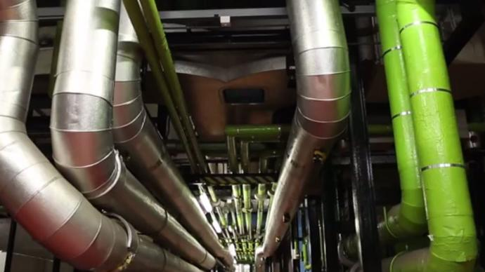 a photo of the barbican centre's engineering room with pipes and other tubes