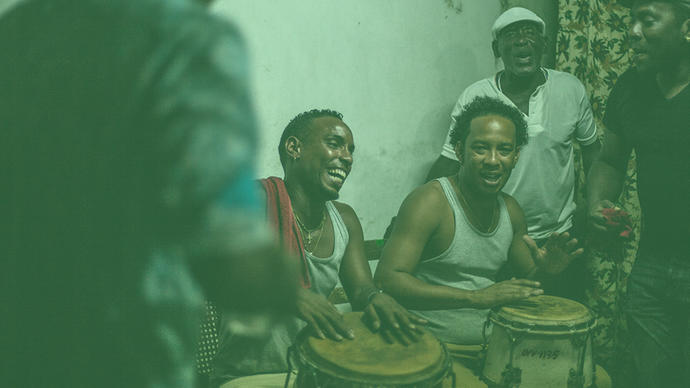 a group of men playing cuban music somewhere in cuba