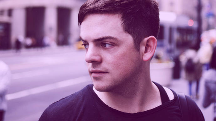 a great photo of music composer nico muhly somewhere in london