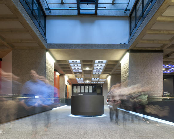 Photo of visitors walking down ramp in Barbican foyers