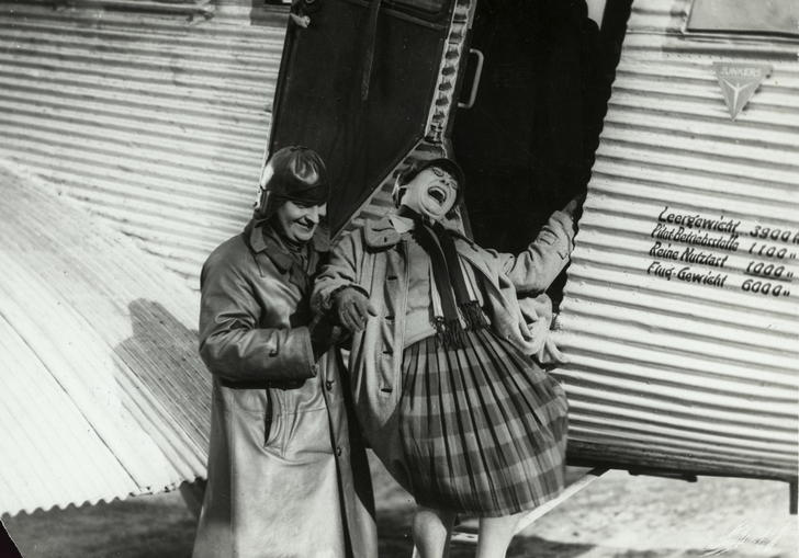 A. Rodchenko and V. Stepanova descending from an airplane.
