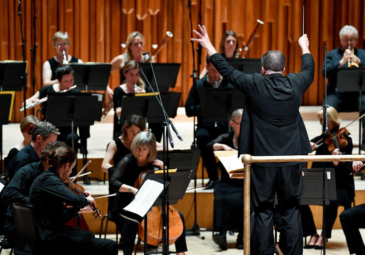 Britten Sinfonia on stage with conductor