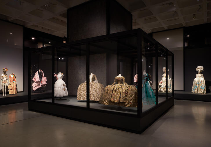 Photo of selection of dresses in a glass exhibition case
