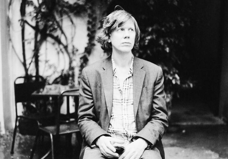 Thurston Moore enjoys a glass of red wine in the guardian whilst looking wistfully off into the distance