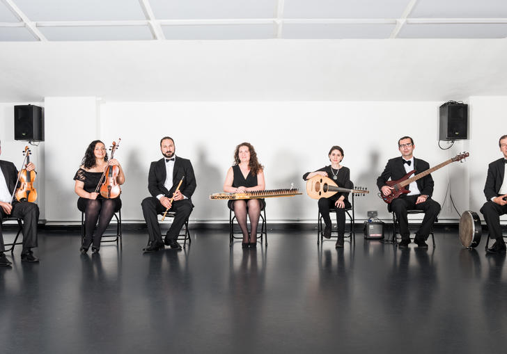 The London Syrian Ensemble sitting in a row