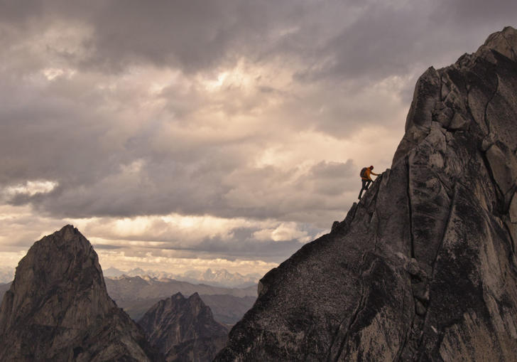 A man climbing a mountain