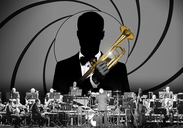 James Bond holding a trumpet behind an orchestra