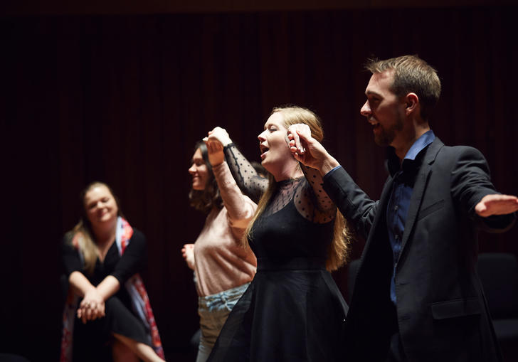 Guildhall singers perform on stage