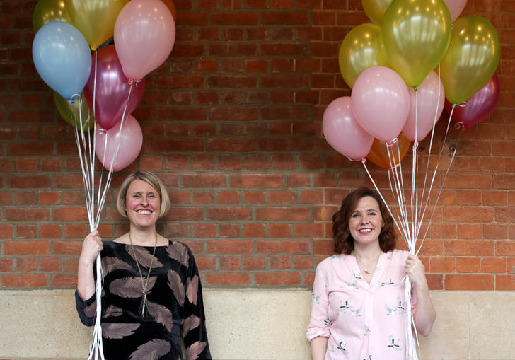 Two women with balloons