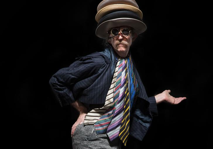 Martin Creed in a selection of hats
