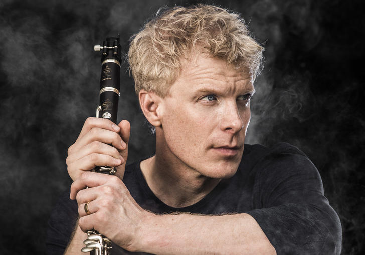martin Frost holding clarinet smoke