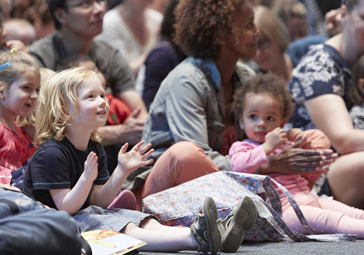 Young children watch a storytelling concert