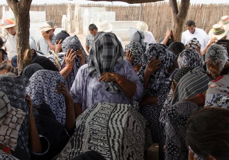 A crowd with scarves on their heads