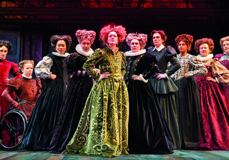 Actresses in Taming of the Shrew pose together on stage with a powerful stance