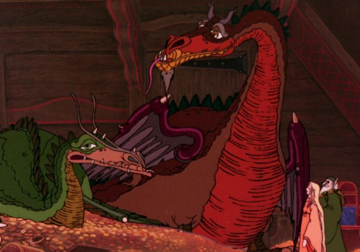 two dragons, one green and one red, sit on a pile of gold with a wizard looking at them