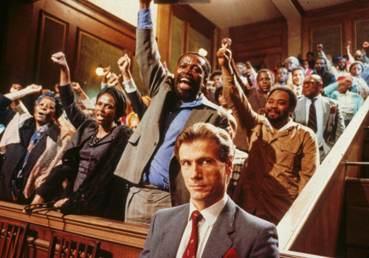 a group of black people standing up in court with their fists raised