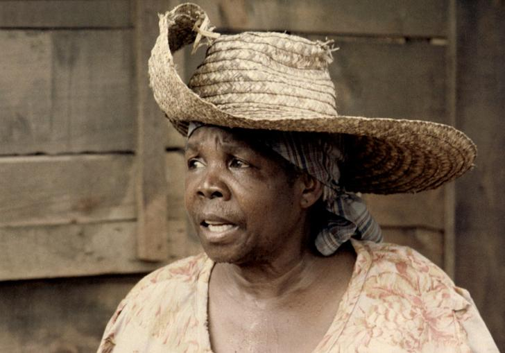An image of Darling Légitimus in Sugar Cane Alley, wearing a wide-brim hat