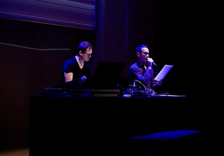 Alva Noto and Anne-James Chaton performing with laptops and a microphone