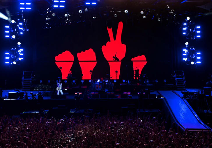 Depeche Mode on stage with blue and red lights